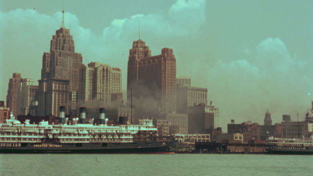 1940's boat point of view past docked cruise ship + buildings in Detroit skyline