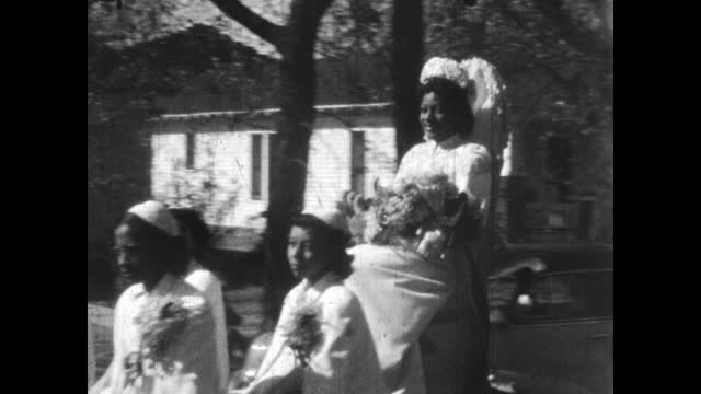 1940's - booker t. washington high school homecoming parade, greenwood, tulsa, ok - ホームカミング点の映像素材/bロール