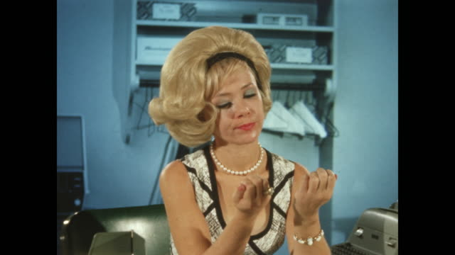 1960's - bored woman with beehive hairdo picks her nails - secretary stock videos & royalty-free footage