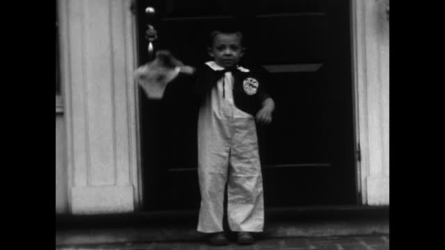 1930's boy in halloween costume poses for camera - jack o' lantern stock videos and b-roll footage