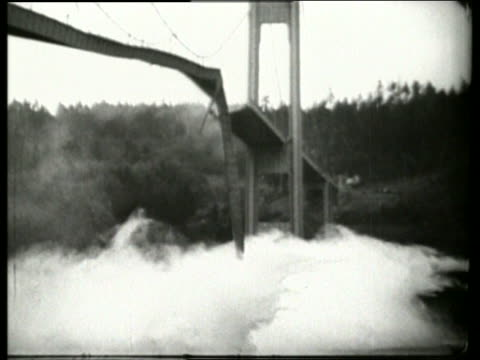 B/W 1940's bridge breaking apart collapsing into river / Galloping Gertie / Tacoma Narrows Bridge