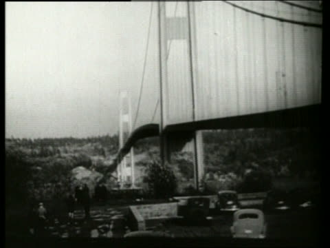 B/W 1940's bridge buckling swaying in wind / Galloping Gertie / Tacoma Narrows Bridge / SOUND