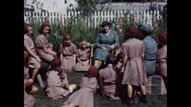 1950's Brownie Girl Scouts and Leaders Assemble for Outdoor Meeting
