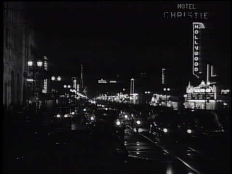 vidéos et rushes de 1930's busy hollywood street at night - 1930