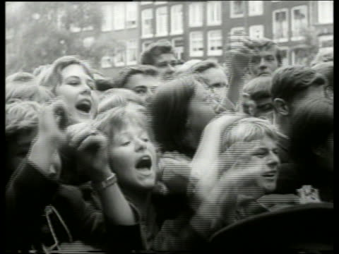 1960's b/w close up of crowd of teenagers screaming / holland - eccitazione video stock e b–roll