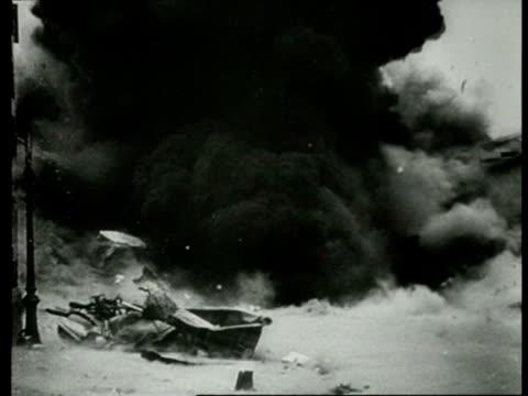 1940's B/W MONTAGE Bombers bombard Rotterdam adults and children seeking shelter / Rotterdam Netherlands