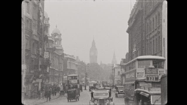 s b/w montage of buses, taxis, goods vehicles and pedestrians in busy street scenes, london, england - 1937 stock videos & royalty-free footage