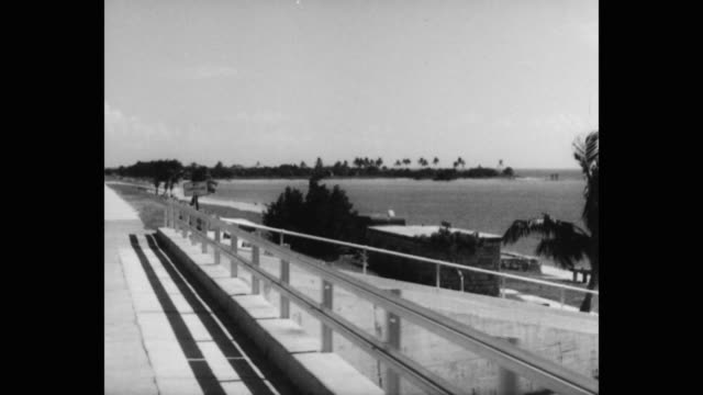 stockvideo's en b-roll-footage met 1950's car pov driving on route 1 into west summerland key, florida, usa - the florida keys