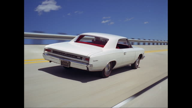 ms pov 1966's car moving on road / united states - collector's car stock videos and b-roll footage