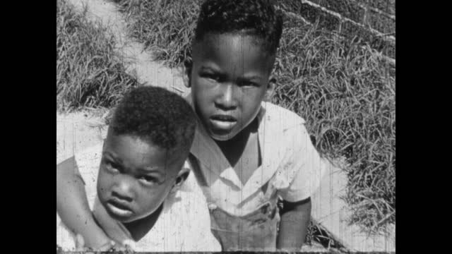 1940's - children outside with their parents, greenwood, tulsa, oklahoma, usa - アメリカ黒人の歴史点の映像素材/bロール