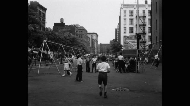 1950's - children playing in playground on west houston street, new york city, new york state, usa - baby boys stock videos & royalty-free footage