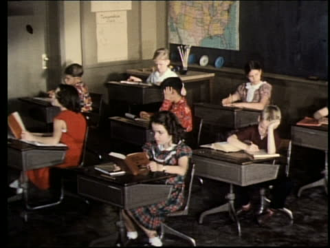 1960's children working at desks in classroom - textbook stock videos & royalty-free footage