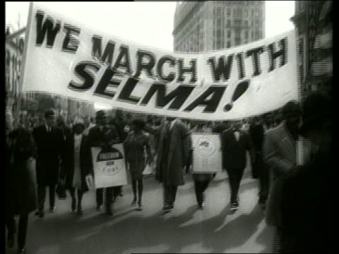 B/W 1960's civil rights march in city street / SOUND