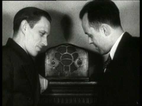 b/w 1930's close up of 2 men listening to radio / no sound - 1930 stock videos and b-roll footage