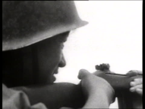 B/W 1960's close up of Asian soldier shooting rifle / Vietnam / SOUND