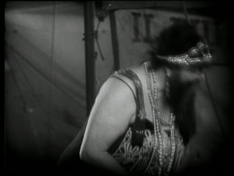 B/W 1920's close up of bearded woman in side show