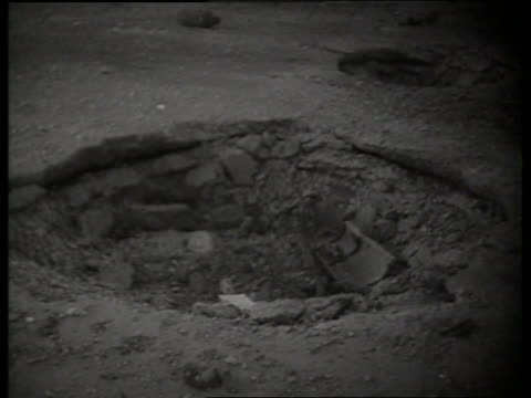 b/w 1960's close up of crater in ground made by bomb / vietnam / sound - volcanic crater stock videos & royalty-free footage