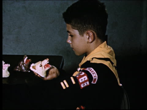 1950's close up of cub scout painting ceramic animal head - cub scout stock videos and b-roll footage