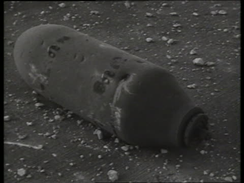 b/w 1960's close up of destroyed airplane part on ground / vietnam / sound - airplane part stock videos and b-roll footage