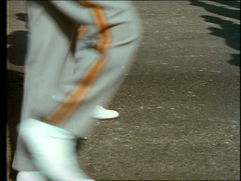 1960's close up of feet of marching band passing camera - marching band stock videos and b-roll footage