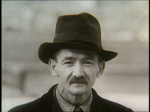 s close up of immigrant man with mustache in hat - moustache stock videos & royalty-free footage