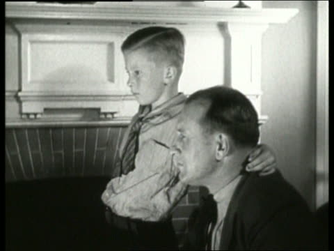 b/w 1930's close up of man and boy / man nods head / listening to radio / no sound - single father stock videos & royalty-free footage