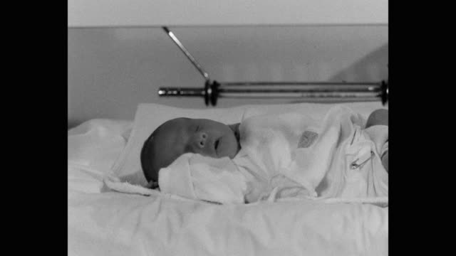1960's - close up of newborn baby sleeping in hospital - babies only stock videos & royalty-free footage