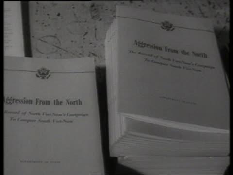 b/w 1960's close up of pile of booklets on vietnam war / sound - einige gegenstände mittelgroße ansammlung stock-videos und b-roll-filmmaterial