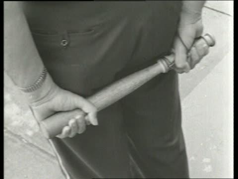 vídeos de stock e filmes b-roll de b/w 1960's close up of policeman's hands holding nightstick / montgomery alabama / sound - maça