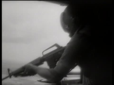 s close up of soldier aiming gun in helicopter / vietnam / sound - vietnamkriget bildbanksvideor och videomaterial från bakom kulisserna