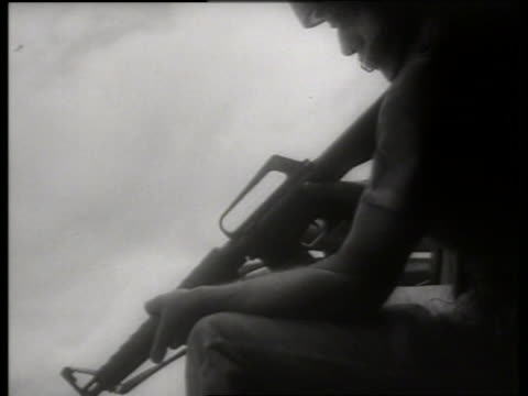 b/w 1960's close up of soldier holding gun in helicopter / vietnam / sound - only mid adult men stock videos & royalty-free footage