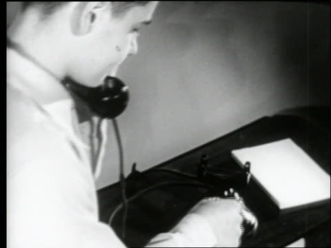 b/w 1950's close up of teen boy dialing telephone / starts to hang up - one teenage boy only stock videos & royalty-free footage