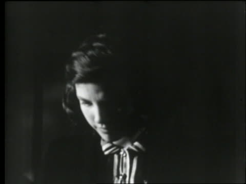 vídeos de stock, filmes e b-roll de b/w 1950's close up of teen girl looking down hurt and dejected / outdoors at night - 1950