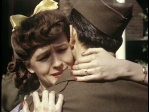 1940's close up of woman hugging + kissing soldier