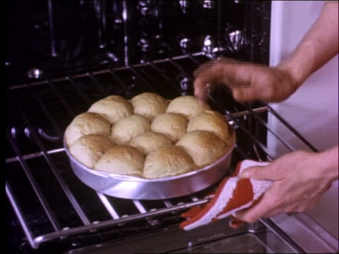 1950's close up of woman's hand checking rolls in oven - buttermilk biscuit stock videos & royalty-free footage