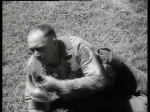 b/w 1960's close up of wounded soldier lying on ground / vietnam / sound - only mid adult men stock videos & royalty-free footage