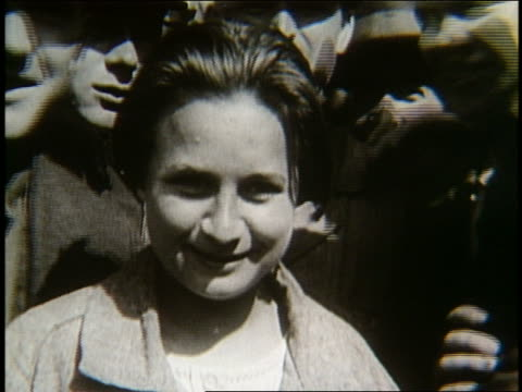 B/W 1900's close up of young immigrant woman smiling