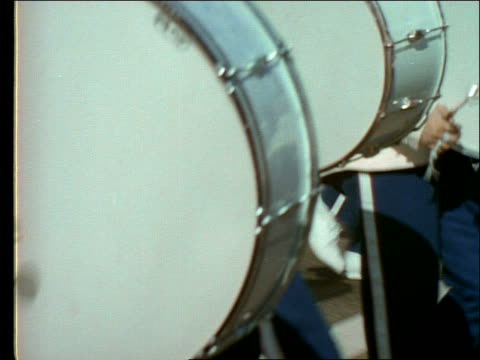 1960's close up pan of people playing drums in marching band - 音楽隊点の映像素材/bロール