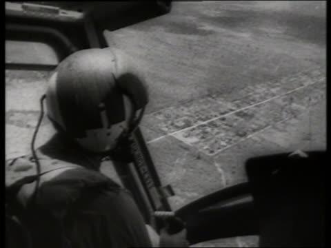 s close up soldier rides in helicopter over countryside / vietnam / sound - solo uomini di età media video stock e b–roll