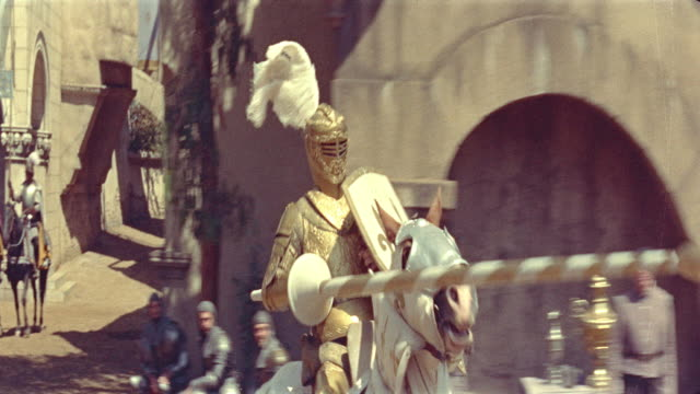 vidéos et rushes de 1500's close up tracking shot knight in armor riding horse in jousting tournament / diane (1956) - reconstitution