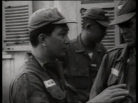 b/w 1960's close up vietnamese soldier talks to us soldier / vietnam / sound - south vietnam stock videos & royalty-free footage