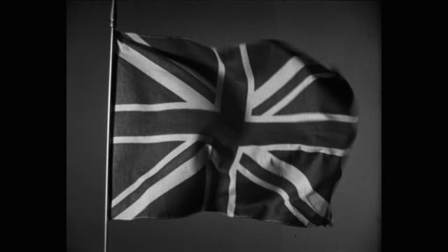 1950's close-up of british flag swaying against sky - swaying stock videos & royalty-free footage