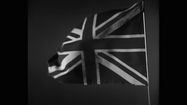 1950's close-up of british flag swaying against sky - union jack stock videos & royalty-free footage