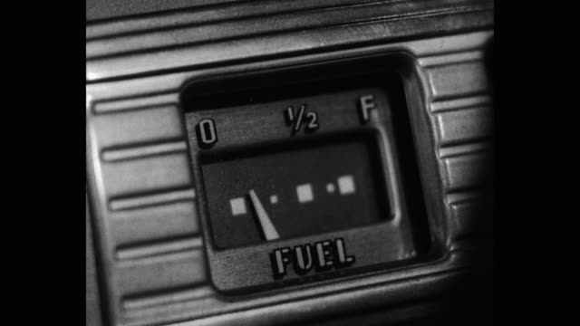 1940's - close-up of car fuel gauge on dashboard - refuelling stock videos & royalty-free footage
