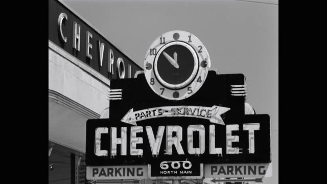 1950's - close-up of chevrolet sign against sky - car showroom stock videos & royalty-free footage