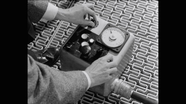 1950's - close-up of man adjusting industrial measuring instrument - accuracy stock videos & royalty-free footage