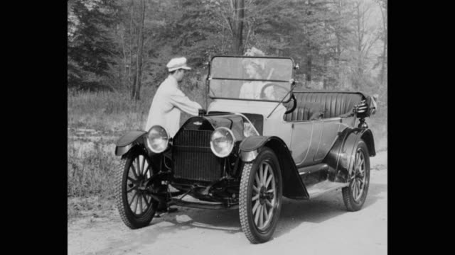 1910's couple talking, getting into vintage car on country road - 1920 video stock e b–roll