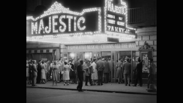1950's - crowd entering in majestic theater showing 'fanny' at night, manhattan, new york city, new york state, usa - broadway manhattan stock-videos und b-roll-filmmaterial