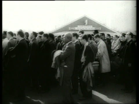 B/W 1960's PAN of crowd in civil rights march / police foreground / Selma Alabama / SOUND
