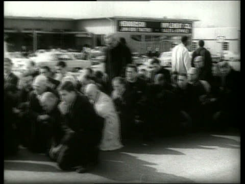 b/w 1960's crowd kneeling in prayer in civil rights march / selma alabama / sound - kneeling stock videos & royalty-free footage